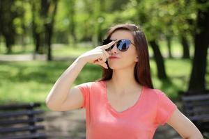 Woman adjusting sunglasses photo