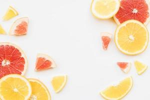 Slices of colorful citrus fruits photo