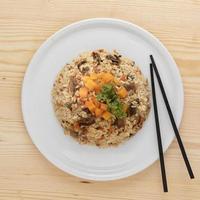 Tasty rice dish with chopsticks photo