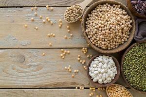 Top view beans arrangement on wooden table photo