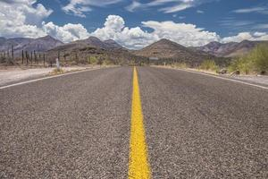 Close up image of the road with mountains and clouds on the sky bottom view desert of Baja California, Mexico photo
