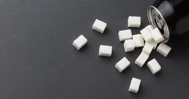 Top view can with sugar cubes and copy space photo