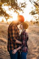 Cheerful guy and girl on a walk in bright knitted hats photo