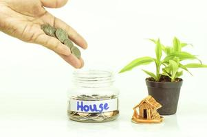Hand putting money in a jar photo