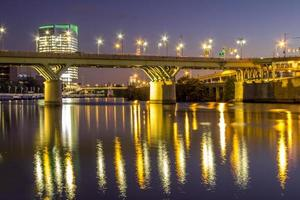 Philadelphia, PA, Nov 13, 2016 - Bridge reflected in water at night photo