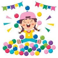 niño divertido jugando con bolas de colores vector