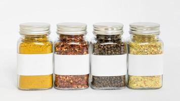 Spices in jars with label arrangements photo