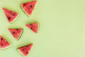 Slices of fresh red fruits photo