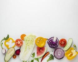 Sliced vegetables white background with copy space photo