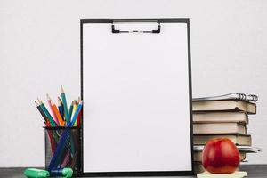 School supplies around easel photo