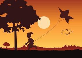 Child flying kite at sunset vector
