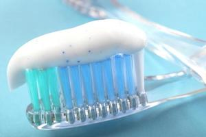 Toothpaste on toothbrush in a simple dental health concept photo