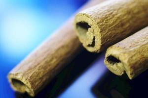 Close up image of cinnamon on blue background photo