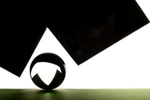 A lens ball on hight contrast geometric background photo