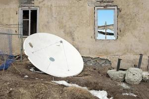 A white satellite and an abandoned house photo
