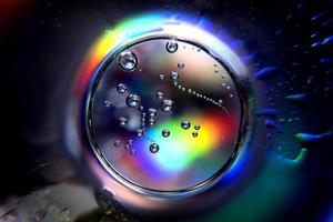 Abstract circle with spectral colors and bubbles photo