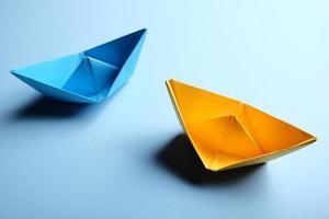 Origamo boats on blue background photo