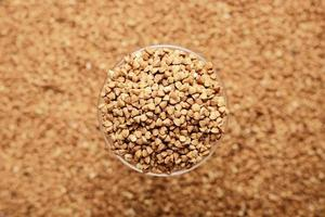 Raw buckwheat in focus and blur photo