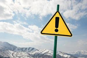 Prohibition sign on a snowy mountain photo