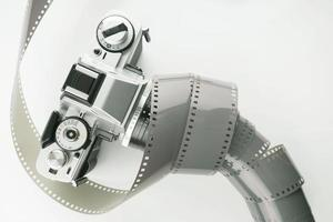 Vintage film camera with a roll of film photo