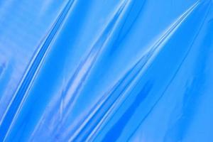 Blue polyethylene background with folds photo