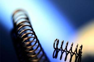 Close up image of iron springs on colorful blurry background photo