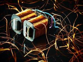 Electricity transformer with copper wire photo