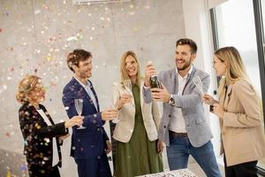 Coworkers celebrating and toasting photo