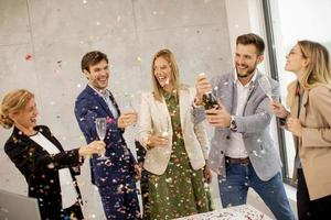 People toasting with confetti falling photo