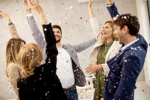 Business professionals celebrating with confetti photo