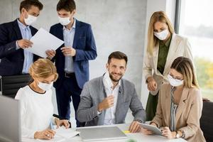 Man taking off mask in meeting photo