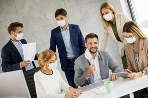 Man with mask off in meeting photo