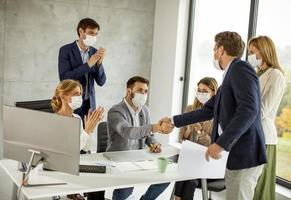 Professionals meeting with masks on photo