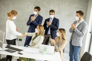 Group of people meeting with masks on photo