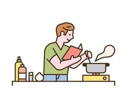 A man is cooking while looking at a recipe book vector