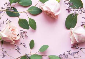 Pink roses and eucalyptus as a border photo