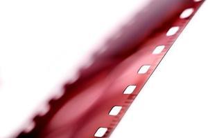 A blurry film strip on white background photo