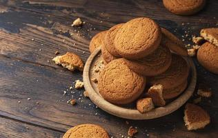 Oatmeal cookies on rustic wooden table with copy space photo