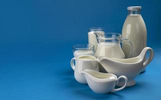 Collection of dairy products on blue wooden background photo