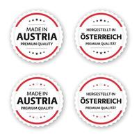 Set of four Austrian labels Made in Austria In German Hergestellt in Osterreich Premium quality stickers and symbols with stars Simple vector illustration isolated on white background