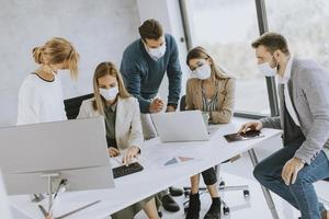 Group in a meeting with masks on photo