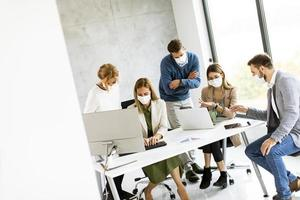 Indoor meeting with people wearing masks photo
