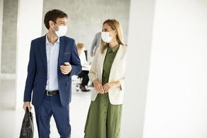 Two masked professionals with copy space photo