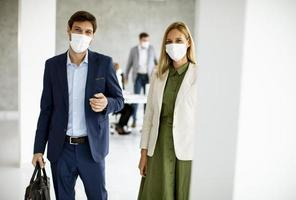 Two masked business professionals with copy space photo