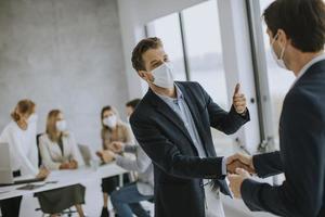 Two masked men talking photo