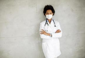 Masked doctor with copy space photo