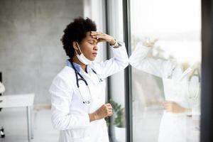 Frustrated doctor looking out window photo