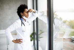 Doctor standing by window with negative expression photo