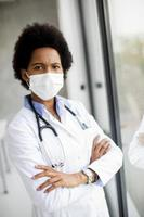 Doctor near window with serious expression photo
