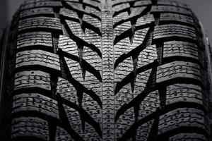 Stack of brand new high performance car tires photo